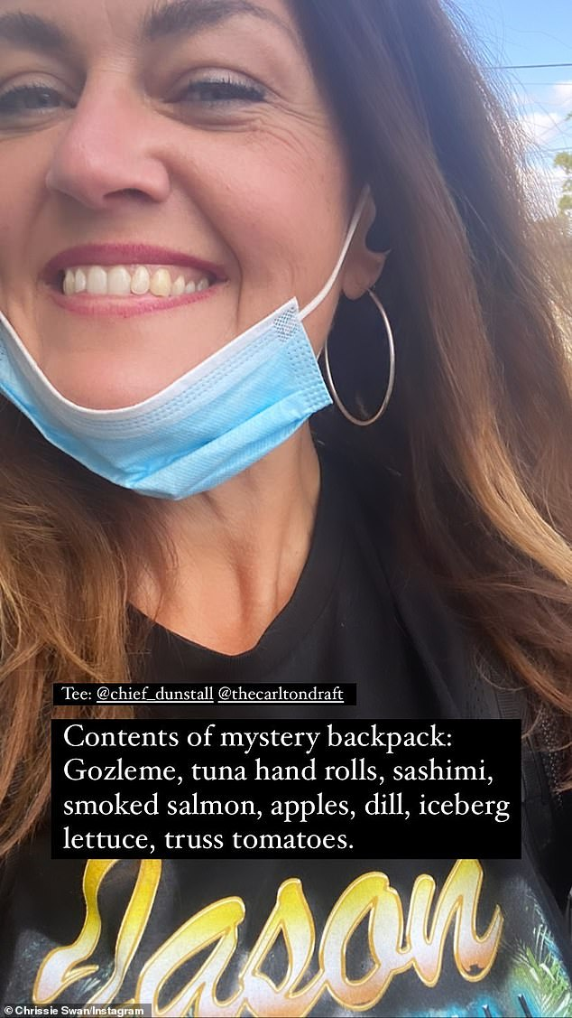 Healthier options: The 47-year-old revealed on her Instagram Story the food she was carry in her backpack, and wrote: 'Contents of mystery backpack: Gozleme, tuna hand rolls, sashimi, smoked salmon, apples, dill, ice berg lettuce, truss tomatoes'