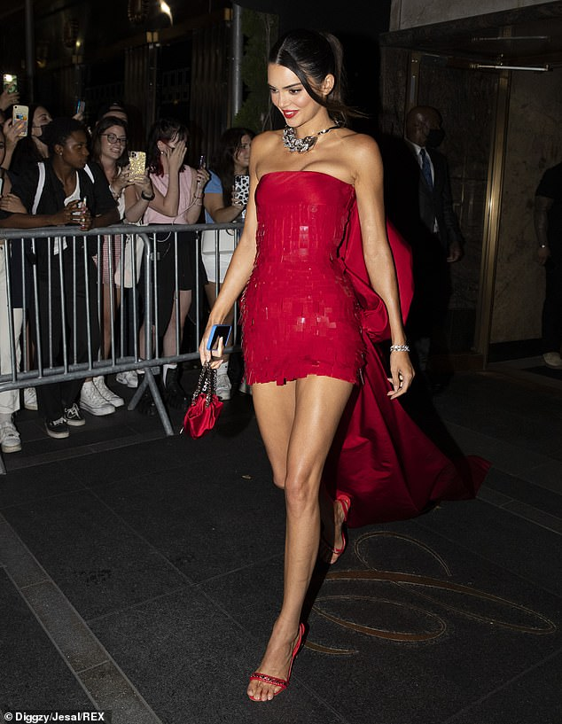 Bright red: The supermodel wowed in red