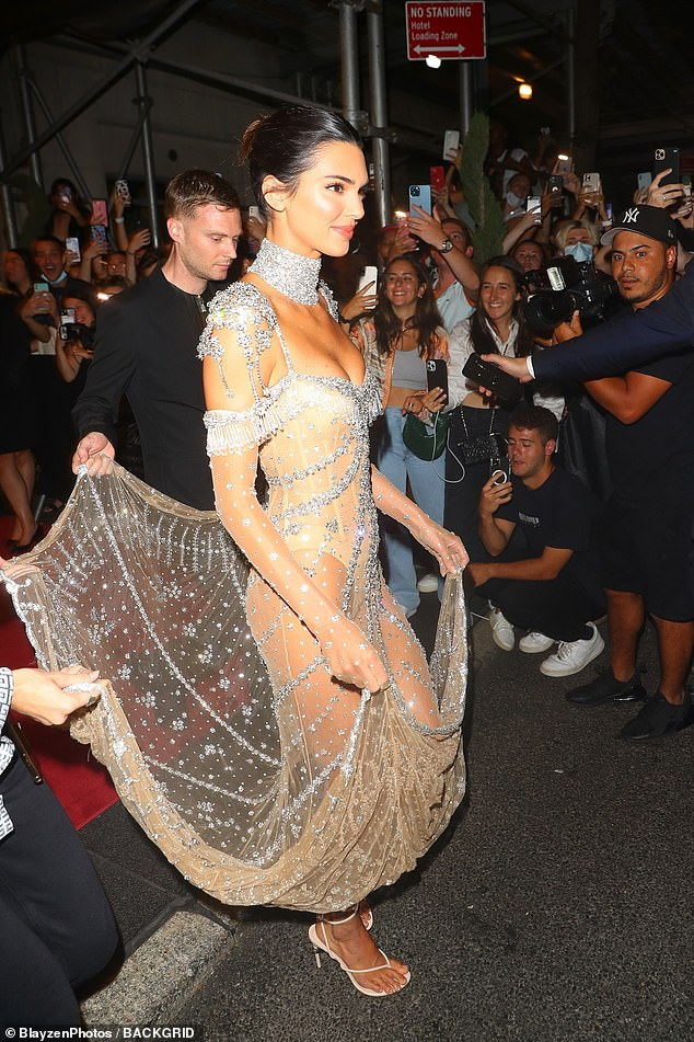 Helping hand: Designer Matthew Williams lifted the delicate train of Kendall's dress