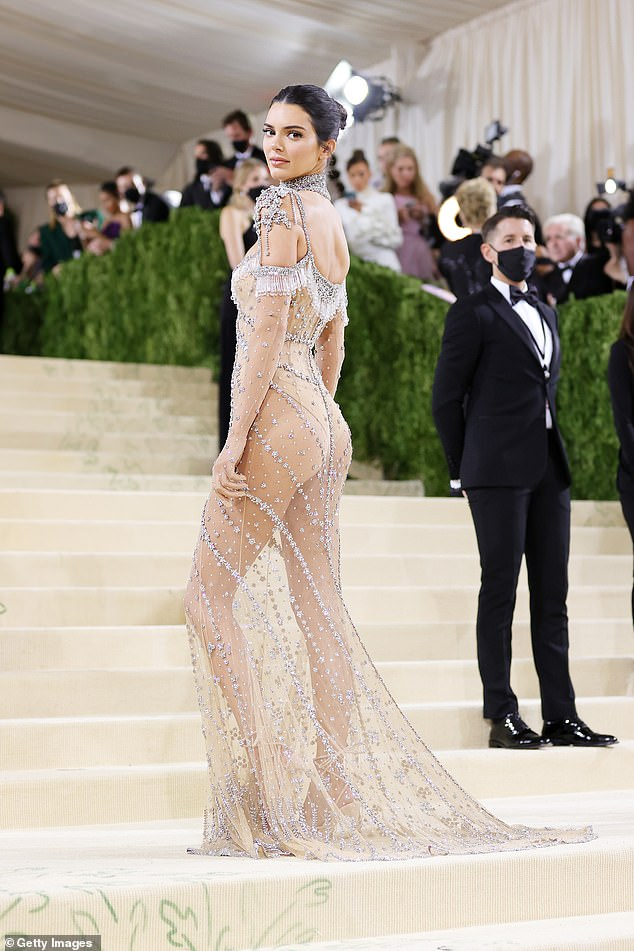 Fierce: Looking back over her shoulder, Kendall flashed photographers a fierce stare