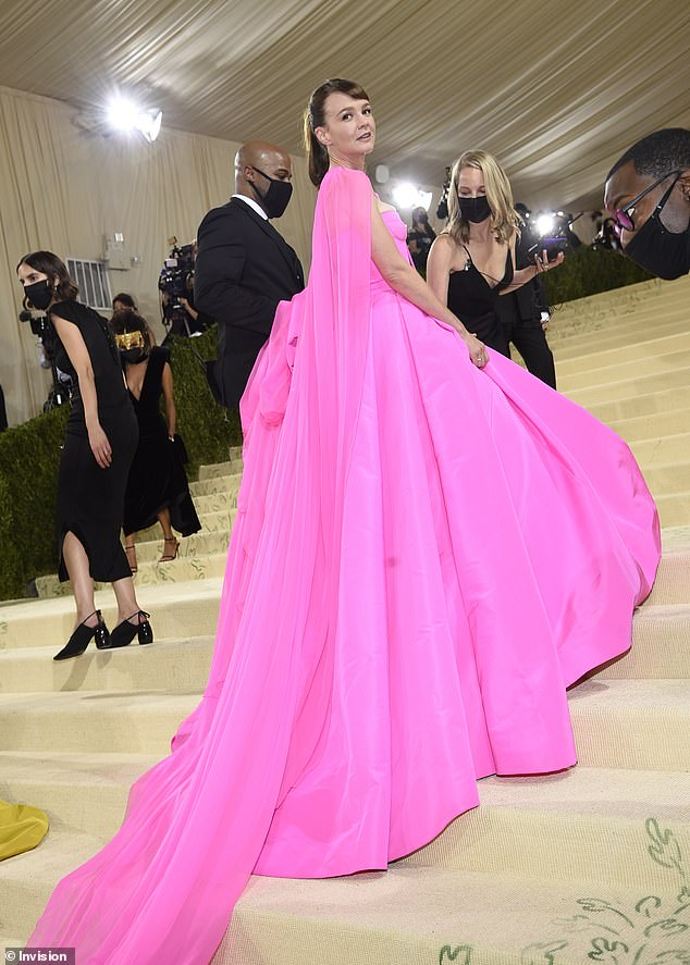 Standout: The actress looked exquisite in the bright Valentino dress as she arrived at the star-studded fashion event