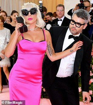 At the last event, Gaga walked the carpet with designer Brandon Maxwell, who helped her to pull off her costume changes