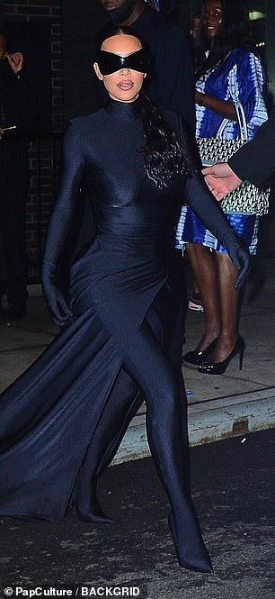 Fierce: The reality personality, 40, showcased her iconic curves in a form-fitting black catsuit, which featured a flowing skirt