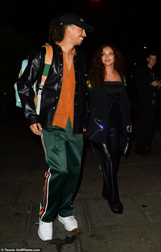 Easy style:Meanwhile Jordan opted for a more colourful look, pairing green tracksuit bottoms with an orange button down cardigan and leather jacket