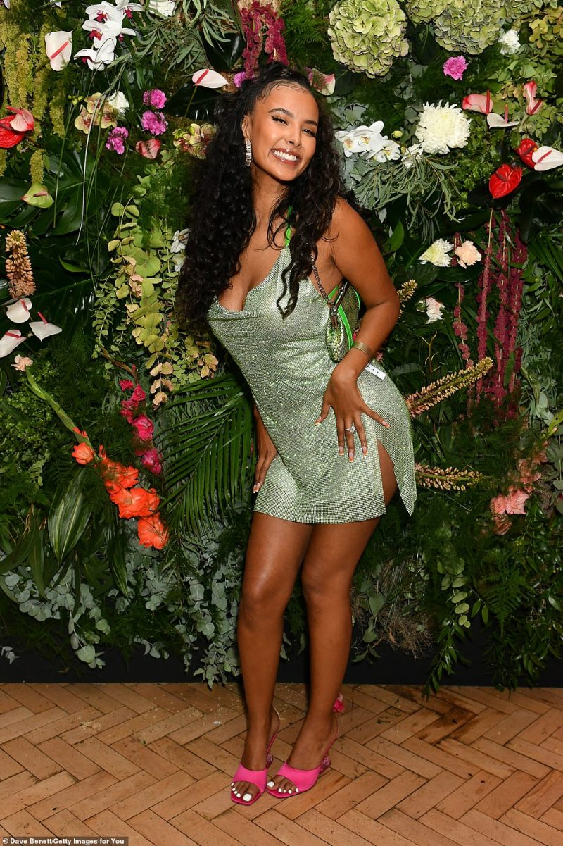 All smiles: The brunette beauty was in good spirits as she attended the event