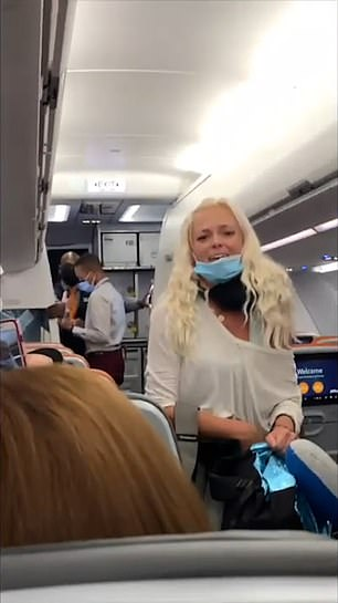 The passenger, whose name has not been released, pulled her mask below her mouth and vowed to sue