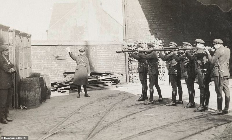Previously-unseen photographs from a soldier documenting the Irish hostilities of the 1920s have come to light a century later in a fascinating album which includes a chilling image of a man standing in front of a firing squad (above). The caption on the execution image simply states: 'Firing squad - execution of a prisoner, Cork 1922'