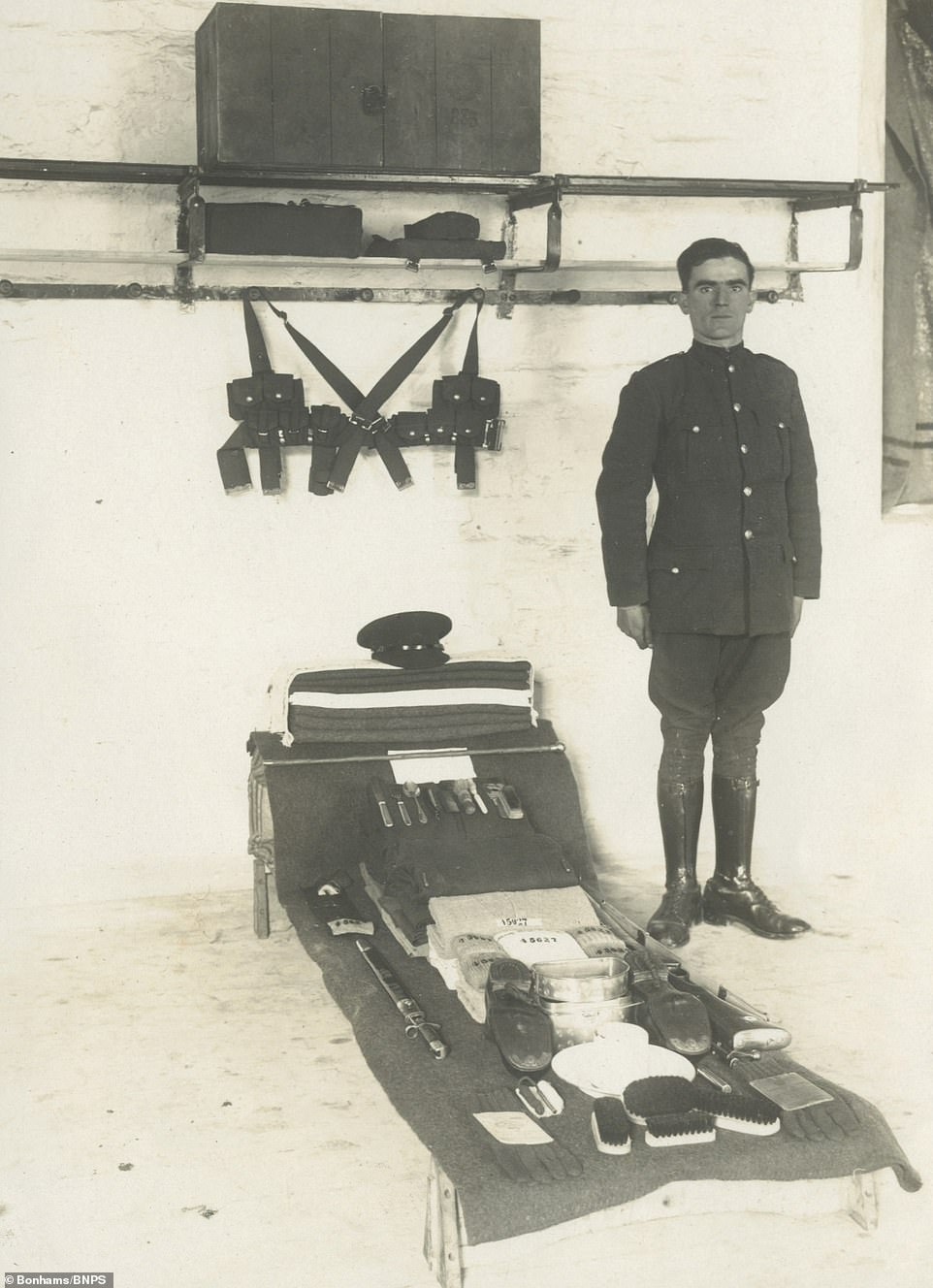 A soldier poses by his bed in one of a series a photographs soldier documenting the Irish hostilities of the 1920s