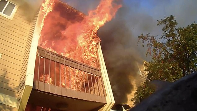 Heavy fire was extending to the attic and roof as residents attempted to evacuate.
