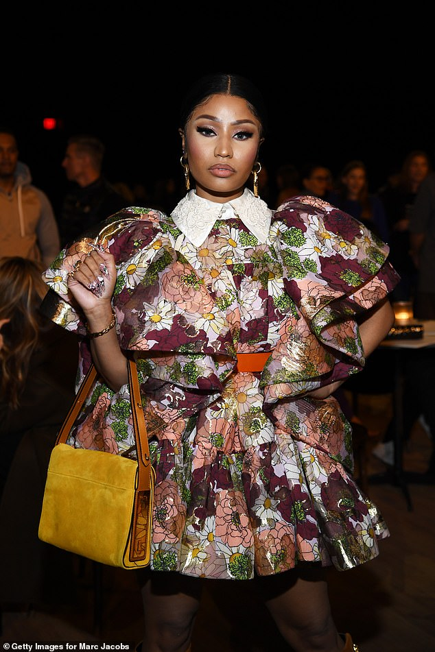 Minaj, 38, took to Twitter Monday to brand Reid a 'lying homophobic c**n' and slam her for 'getting ur dumb a** on tv a min after a tweet to spread a false narrative about a black woman'