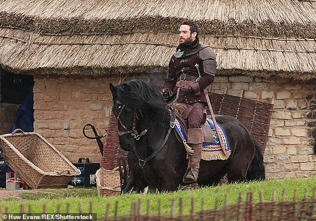 On set: The pop star came to set to visit Joshua, who Vinnie calls an 'English knobhead,' on set.'She was lovely, but I thought, oh no – she's a rabbit in the headlights with this geezer, it's all bollocks,' he told the radio show. Joshua is pictured onGalavant