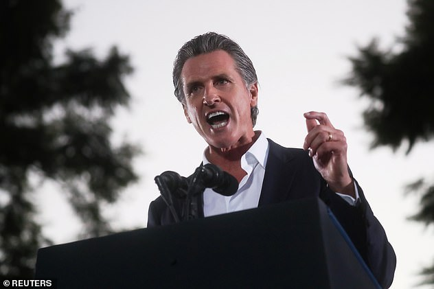 Democratic Gov. Gavin Newsom is favored to stay in office. On election eve, he appeared at a rally in Long Beach, California alongside President Joe Biden
