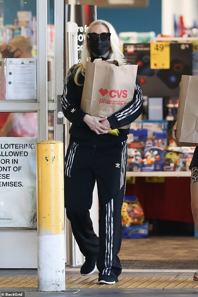 Keeping it casual:Erika Jayne traded in the glamour for a tracksuit as she ran errands at CVS Pharmacy in Beverly Hills on Monday