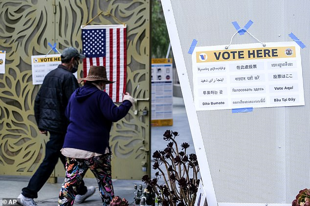 Voters arrive to cast their ballots at the Lincoln Park Senior Center in Los Angeles Tuesday