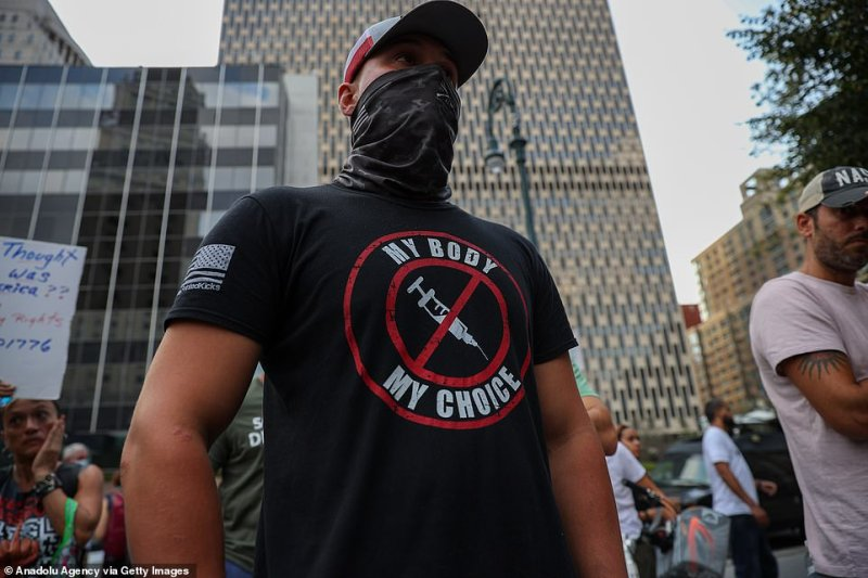 An anti-vaccine protester wears a shirt that reads 'My body my choice' during a rally in New York City on Monday