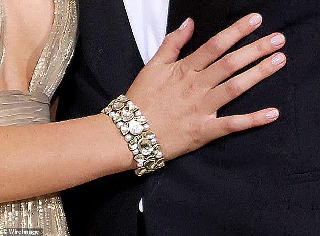 Bling: She also worea chunky bracelet set with glistening stones