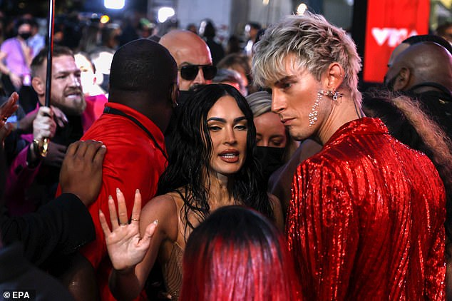 Confrontation:The MMA fighter, 33, branded Kelly, 31, a 'little vanilla boy rapper' after they were squared up on the red carpet with their respective partners - Megan Fox (pictured) and Dee Devlin - by their sides just before the start of the show