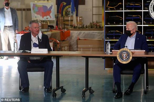 President Joe Biden (right) sits alongside Idaho Gov. Brad Little (left), a Republican, at the National Interagency Fire Center