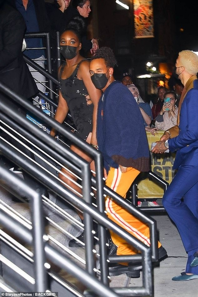 Event: Lewisalso sported a pair of bright yellow tracksuit bottoms and black shoes and appeared to arrive at the bash with another woman