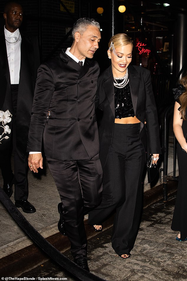 Stepping out: Rita Ora, 30, and boyfriend Taika Waititi, 46, missed Tessa Thompson, 37, as they left a Met Gala afterparty following the trio's three-way kiss earlier this year