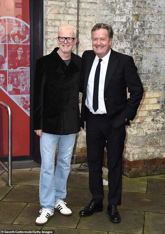 Fighting Spirit: Piers Morgan, 56, and Chris Evans, 55, appeared in a jovial mood at the Who Care Wins Awards 2021 on Tuesday, as Piers argued with Nicki Minaj.
