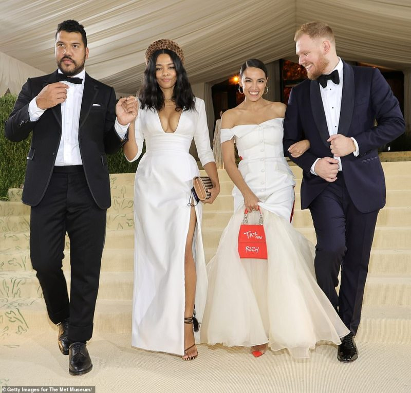 AOC with her boyfriend Riley Roberts (far right), her dress designer Aurora James and Benjamin Bronfman (far left), James' partner who is the heir to Seagrams Company Ltd. The group was pictured leaving at midnight. AOC claimed she'd been 'invited' as an elected official. DailyMail.com understands that Conde Nast did not comp them