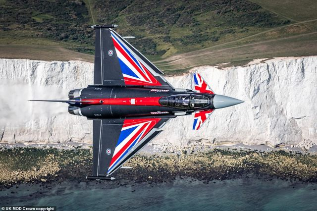 A red, white and blue RAF Typhoon soars over the White Cliffs of Dover ahead of Battle of Britain Day today