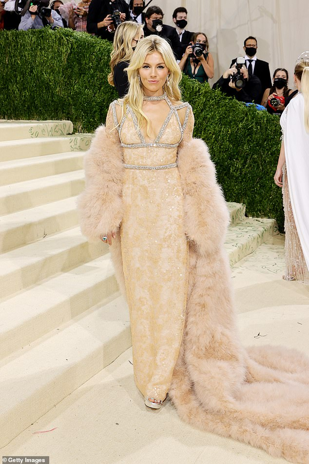 Sienna Miller channeled Old Hollywood glamour in a Gucci gown with a trailing faux fur coat