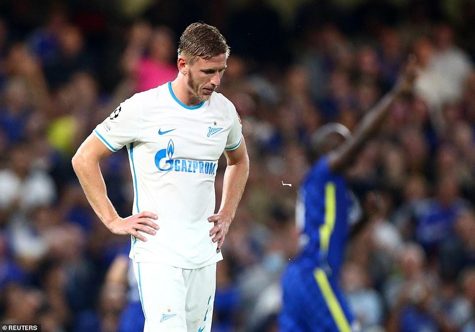 Zenit St Petersbug's Dmitriy Chistyakov looked dejected as Lukaku and Chelsea players celebrated their header