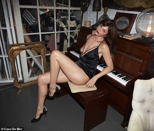 Jaw-dropping: Helena was perched on a piano seat and posed with one leg in the air for this image while sporting a pair of black stilettos