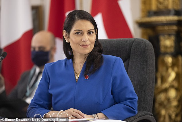 Priti Patel (pictured) last night risked the ire of the Attorney General after her Twitter account labelled a man being arrested in a video as a 'vile people smuggler'