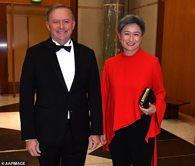 Senator Penny Wong (right with Mr Albanese) was born in Malaysia and moved to Adelaide aged eight