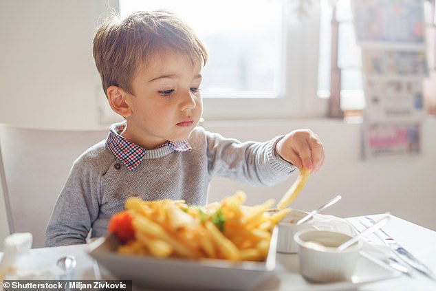 The French influencer and former GBBO contestant says she worries about bringing up her four-month-old daughter Fleur in England where snacking is endemic (stock image)