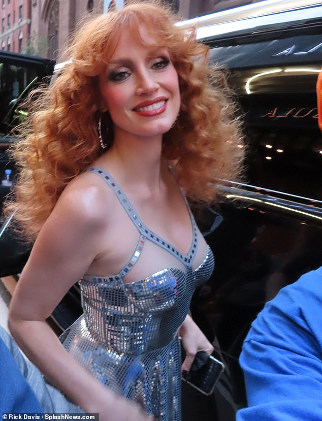 Fanfare: Before heading into the premiere's venue, Jessica was captured exiting her chauffeured SUV and greeting fans