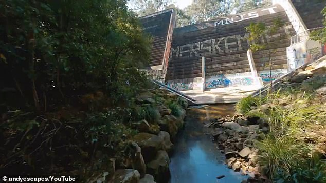 A photographer has shared his very chilling video of 'Australia's Jurassic Park' after stumbling across a heavily graffitied dam while exploring his neighbourhood