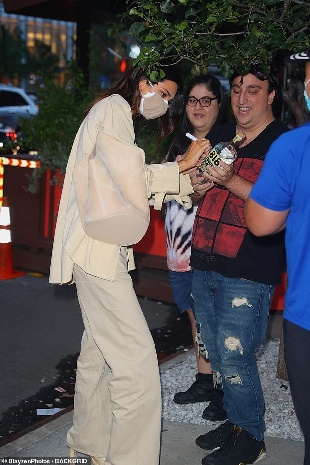 Broken!  Kendall was seen, still in New York, the day before, accosted by fans - one of whom asked her to autograph a bottle of tequila