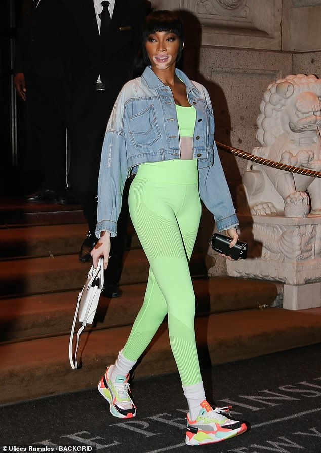 Color coordination: The fashion industry personality also wore a light blue denim jacket that offset the shade of her clothing