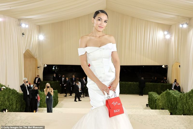 Alexandria Ocasio-Cortez may want to 'Tax the Rich' but she certainly fit in with the rich and famous at Monday's Met Gala thanks to a host of luxury freebies she bagged for the evening