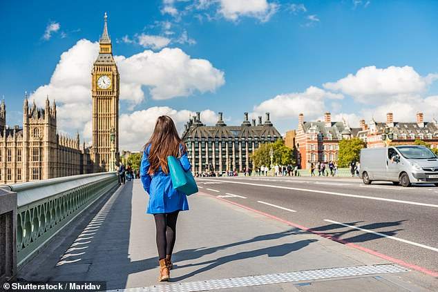 Qantas has confirmed it would ban unvaccinated passengers from travelling on international flights (pictured, a tourist in London)