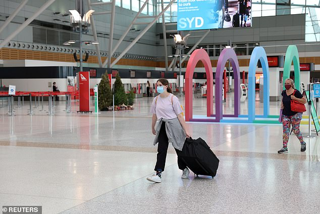 As it stands, 43.2 per cent of eligible Australians have had two doses of a Covid vaccine (pictured, a woman in Sydney's domestic airport)