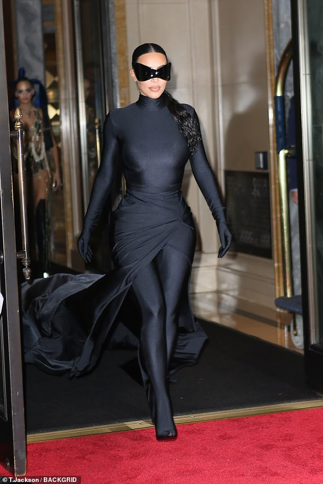 On the prowl:She stepped back into her five-star hotel before quickly emerging in a quirky outfit reminiscent of Batman supervillain Catwoman