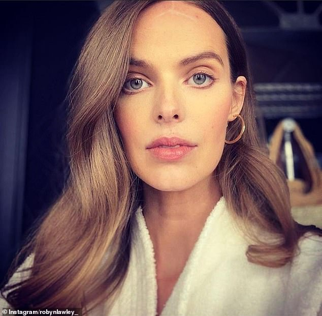 Marked: Robyn, who was diagnosed with lupus in 2015, was left with severe bruising and a lightening bolt-shaped scar in the centre of her forehead. She said: 'I could remove the facial scarring. However, I ask the question: why? Why are we obsessed with perfection'