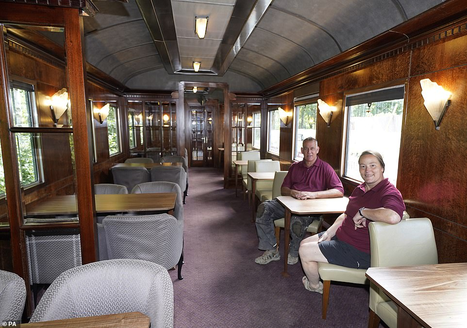 Di and Simon relax in one of their movie carriages. During filming the tables were Velcroed into position so that they could be moved easily
