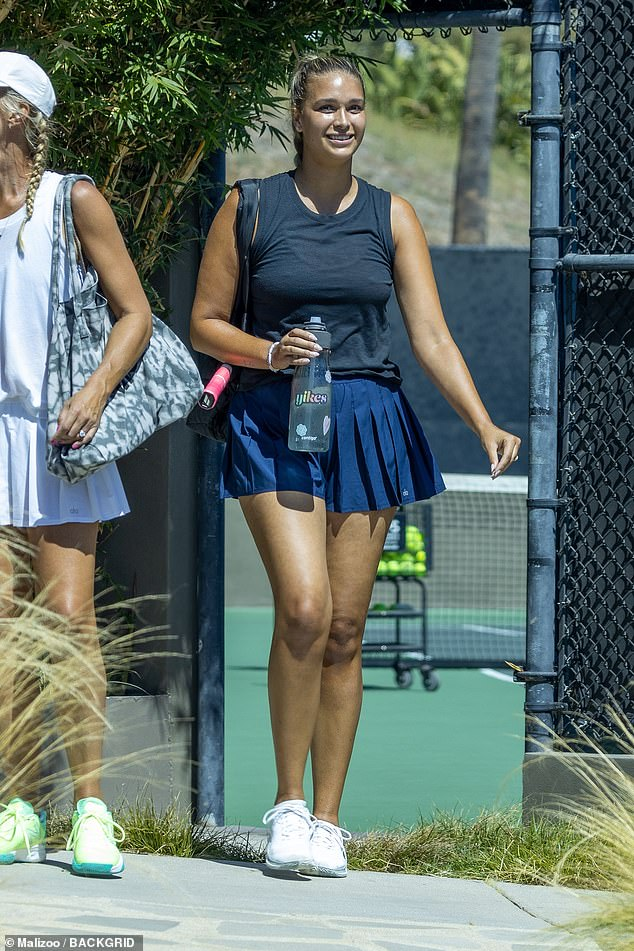 Serving up heat: April Love Gearyflaunted her model legs in a very tiny blue tennis skirt while playing doubles tennis with longtime partner Robin Thicke in Malibu on Thursday