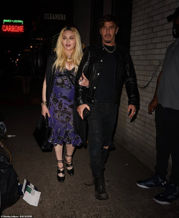 Stepping out:Also at the bash was music legend Madonna, 63, who wore a blue and black dress teamed with a black cape and stiletto heels