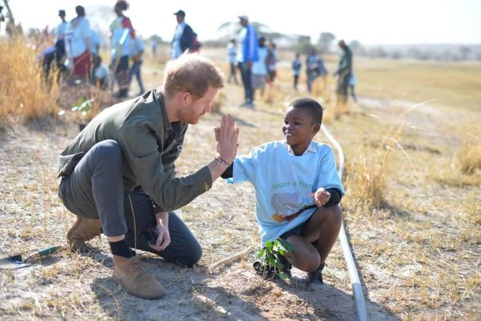 The royal family shared a photo of Harry meeting a baby in Botswana in September 2019 during a visit to Kasane Health Post run by Sentebel charity in Kasane.