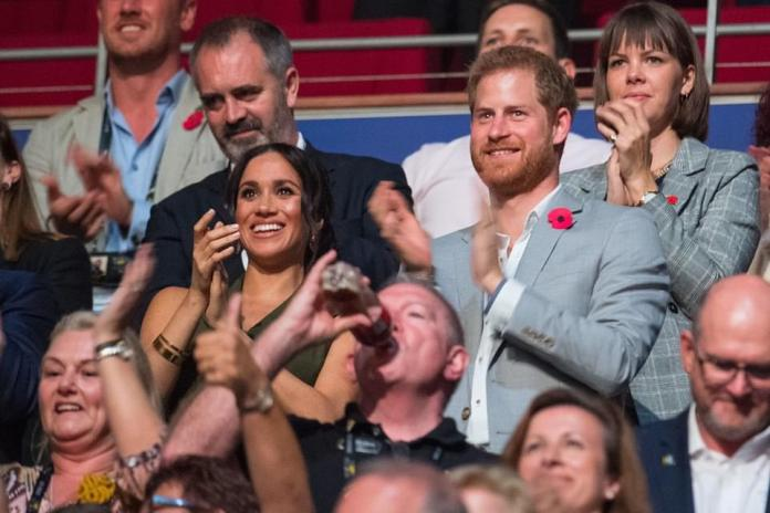 The Queen posted a photo of Harry and Meghan at the Invictus Games in 2018 at their final engagement in Australia before heading to New Zealand