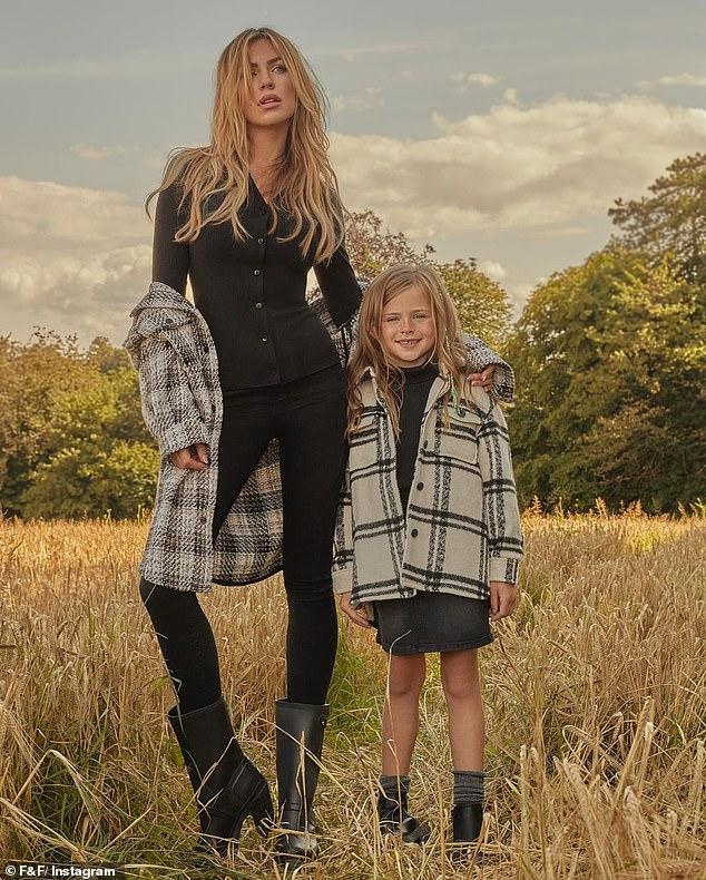 Sweet: The six-year-old is Abbey's mini-me as the pair posed in the countryside in checked coats