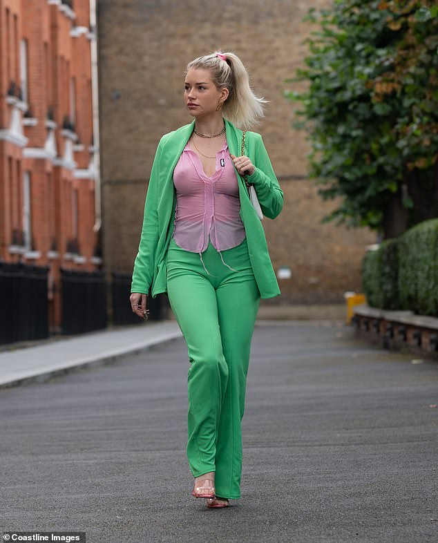 Stepping out: Lottie Moss commanded attention as she went braless in a sheer pink shirt while out on a stroll in Chelsea on Tuesday