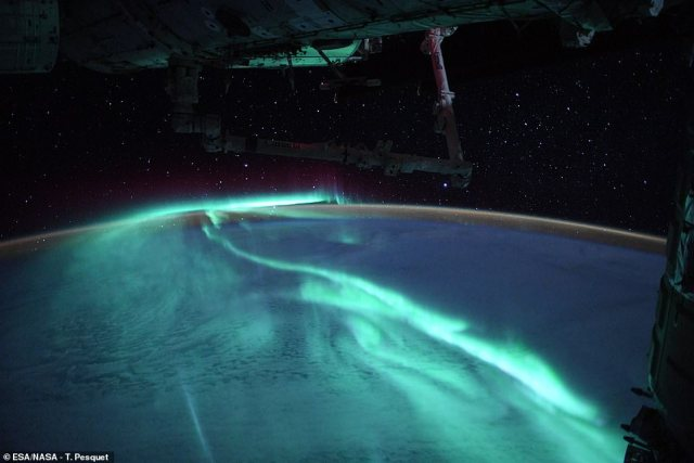 Auroras occur when electrically charged sun particles enter the Earth's atmosphere and collide with oxygen and nitrogen particles